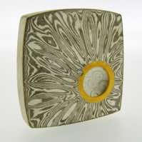 Radiant patterned 18k white gold and silver mokume gane fower neukit brooch with 22k gold rimmed cutaway and diamond detail. Price £1950