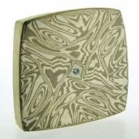 Torsion patterned 18k white gold and silver mokume gane fower neukit brooch with diamond detail. Price £1800