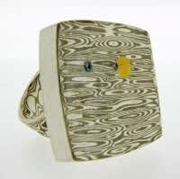 Transit Ring in 18k white gold and silver mokume gane with 22k gold and diamond details.  POA.
