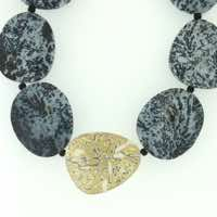 Irregular form dendritic agate beads with mokume gane detail in 22k gold, 18k white gold and silver.  POA.