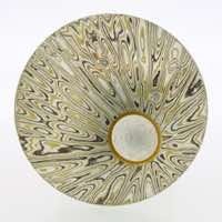 Radiant patterned 22k gold, 18k white gold and silver mokume gane discus brooch (49mmø) with 22k gold rimmed cutaway and diamond detail. POA.