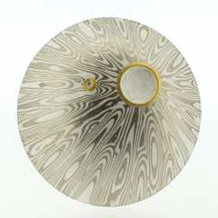 Radiant patterned 18k white gold and silver mokume gane discus brooch (49mmø) with 22k gold rimmed cutaway and diamond detail. Price £1900