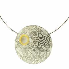 18k white gold and silver mokume gane discus pendant with 22k gold rimmed cutaway and diamond detail.  POA.