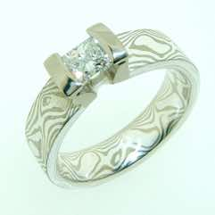 18k white gold and silver mokume gane 5mm flat band with a 0.35ct princess cut diamond in an 18k white gold double bar setting