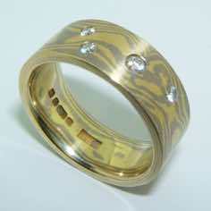 18k white and yellow gold mokume gane 7mm flat band with four brilliant cut diamonds in a random scatter<br/><br/>£POA