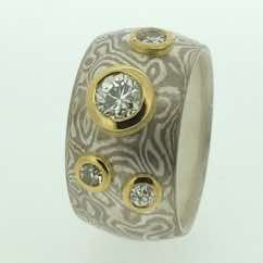 Wide 18k white gold and silver mokume gane band with brilliant cut diamonds in very low 22k gold rubover settings